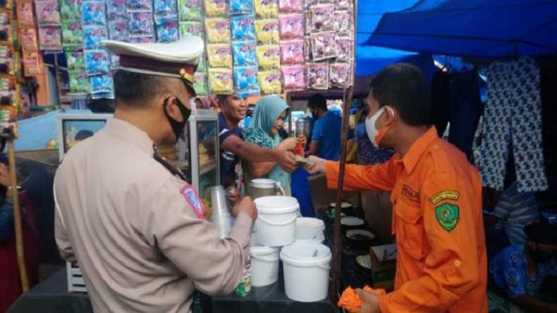 Kapolres Tapsel Lakukan Operasi Yustisi Prokes di Pasar Pargarutan, Angkola Timur Tapsel