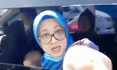 Polisi Datangi Rumah Wanita Berkerudung yang Maki Petugas ,Nitizen Minta Pelaku Ditangkap