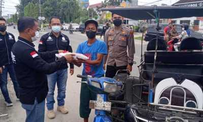 Sat Reskrim Polres Tanjungbalai Gelar Bansos Peduli Kasih lKepada Warga Terdampak Covid-19